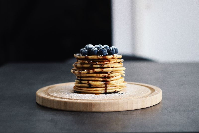 Close-up of pancakes with blueberries on table