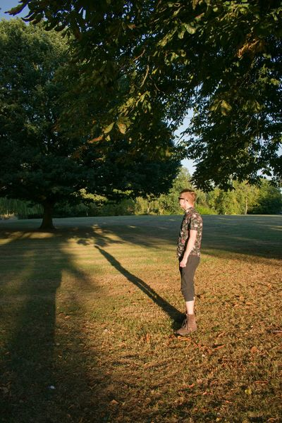 Shadows in the Park Mid Summer Shadows & Light Evening Son Triangular Tree Full Length Blond Hair Standing Grass