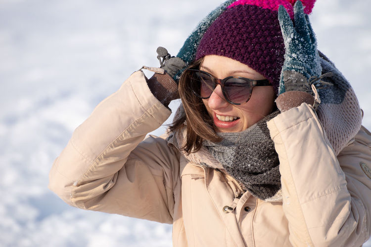 Portrait of a smiling woman in snow