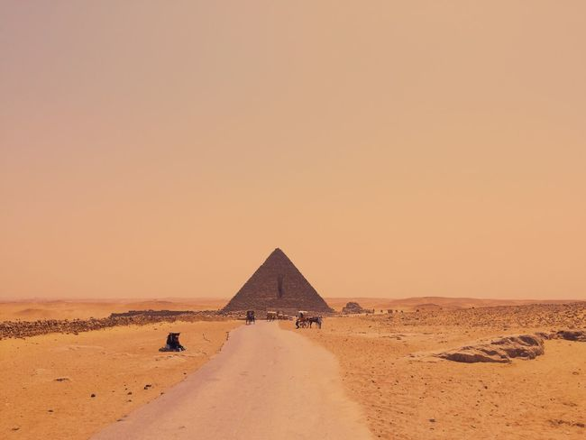 Smallest pyramid Exploring Minimalism Simplicity Yellow Orange Color Desert Land Sky Sand Climate Pyramid The Architect - 2018 EyeEm Awards Architecture Scenics - Nature Tranquil Scene Nature Landscape Built Structure History Environment The Past Clear Sky Tranquility