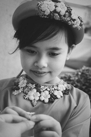 Girl holding tiny flower