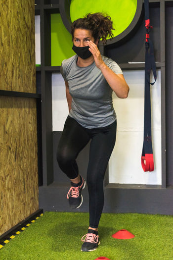 Full length of woman exercising