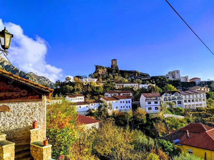View of townscape against blue sky