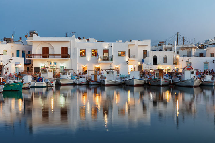 View to the village of Naousa on Paros island, Cyclades, Greece, at evening time Aegean Light Mediterranean  Paros Architecture Bar Building Exterior Cyclades Evening Greece Harbor Illuminated Island Marina Moored Nautical Vessel Reflection Restaurant Sea Sky Tourism Travel Destinations Water Waterfront Yacht