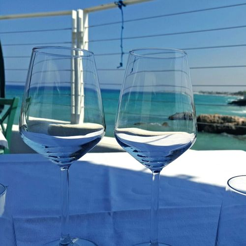 Table Sea View Sun Paesaggio Blue Water Sabbia Sun Day Sea Estate Blue Colori Cielo Acqua Weather Sky Colors Vista Mare Art Is Everywhere Visual Feast Food And Drink Drinking Glass Wineglass Refreshment Drink No People Day Martini Glass Outdoors Alcohol Freshness Summer Exploratorium The Traveler - 2018 EyeEm Awards