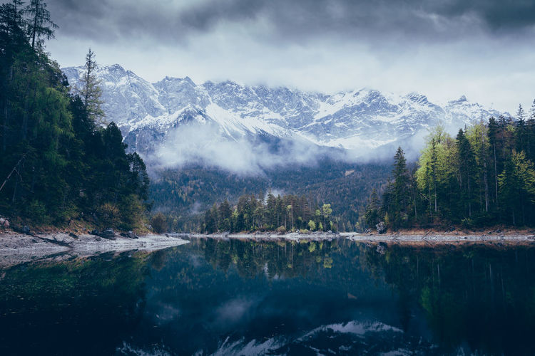 It's kinda sad that I never upload to EyeEm anymore... Beauty In Nature Cold Temperature Day Idyllic Lake Mountain Mountain Range Nature No People Outdoors Reflection Scenics Sky Snow Snowcapped Mountain Tranquil Scene Tranquility Tree Water Winter