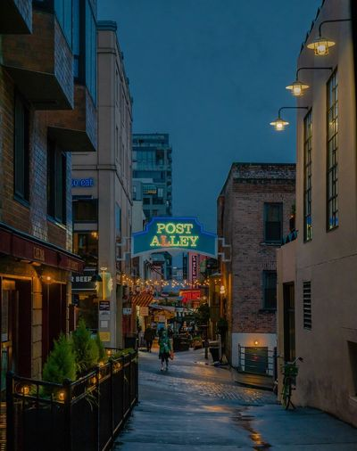 Post Alley Night Street Photography Street Photography Compositionkillerz Night Photography Streetphotography Nightphotography Night Lights New Things  Foreground EyeEm New Here Architecture Building Exterior City Night Illuminated Built Structure Street Building Sky Nature Office Building Exterior Street Light Incidental People The Way Forward City Street Outdoors Skyscraper Residential District City Life Office