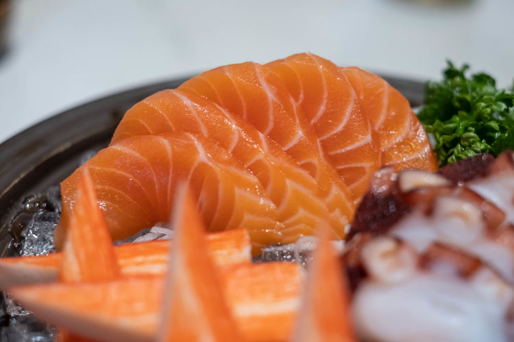 Close-up of orange fish in plate