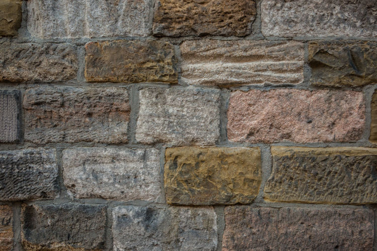 Old wall of a historical building with different colored stones Architecture Backgrounds Wall Built Structure Full Frame No People Solid Wall - Building Feature Stone Wall Stone Material History Textured  Brick The Past Rough Brick Wall Old Pattern Day Close-up
