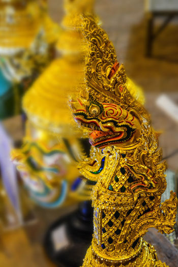 Bangkok Thailand. Art And Craft Carving Chinese Dragon Close-up Day Dragon Focus On Foreground Gold Colored Line Thai Mask No People Outdoors Place Of Worship Religion Sculpture Sculptures Spirituality Statue Yellow