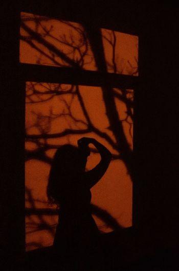 Shadow of woman on window