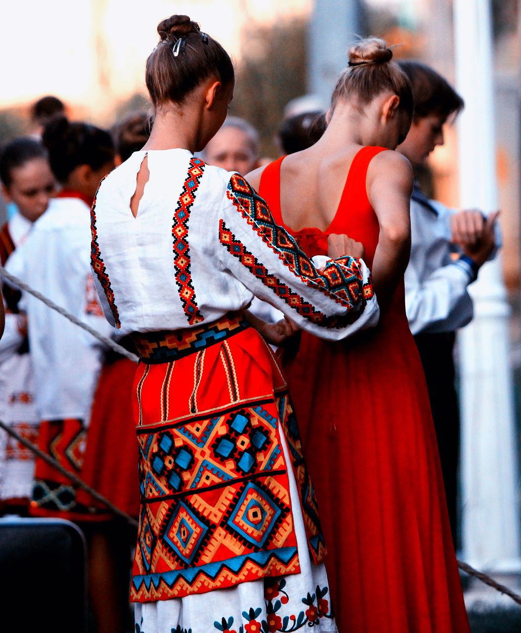 real people, traditional clothing, cultures, focus on foreground, traditional dancing, tradition, celebration, lifestyles, day, performance, togetherness, outdoors, young adult