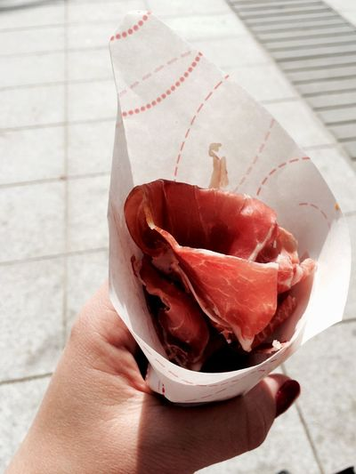 Cropped Image Of Woman Holding Cone With Sliced Ham