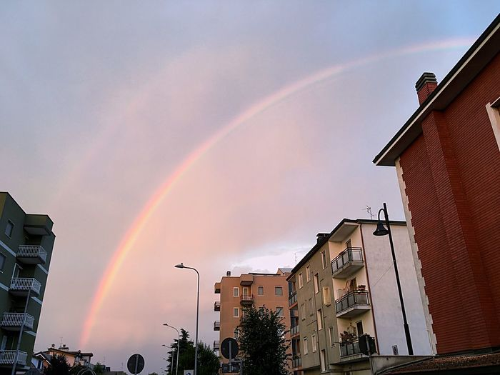 Building Exterior Architecture Rainbow Built Structure Sky Building Low Angle View