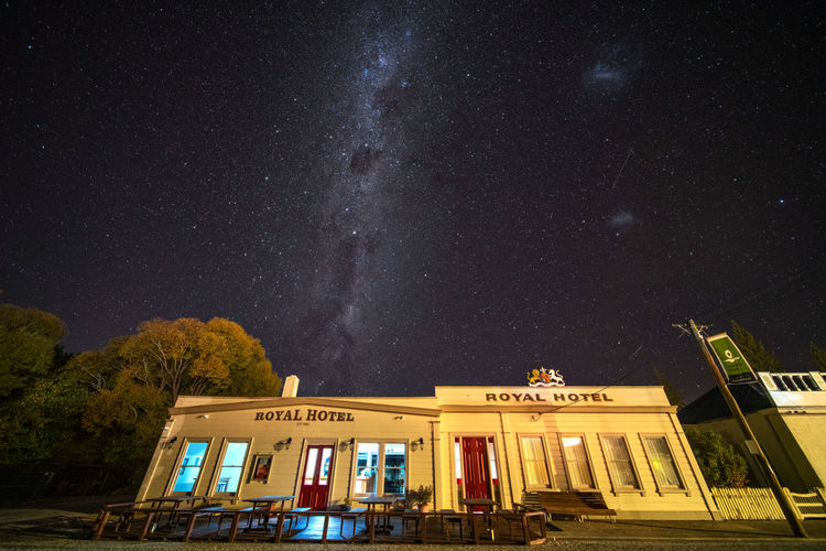 Night Star - Space Architecture Space Sky Astronomy Galaxy Building Exterior Built Structure Nature Star Star Field Low Angle View No People Illuminated Building Scenics - Nature Text Constellation Outdoors Milky Way New Zealand Royal Hotel