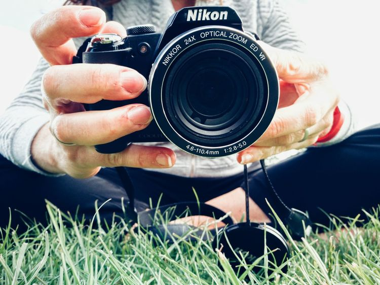 Human Hand Human Body Part Photography Themes Camera - Photographic Equipment Photographing Grass Outdoors Technology Day Person Taking Pictures! Photos Close-up Light Taking Photo At Camera Lifestyles Taking Pictures In The Park Photography Lovers Pasion For Photography Black Camera Photographer Nikon Camera Nikon Coolpix P90 Person Taking Pictures