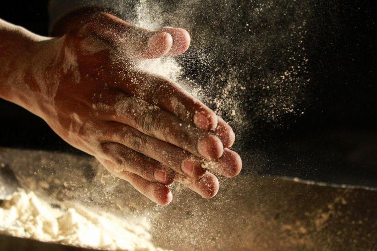 Cropped hands splashing talcum powder