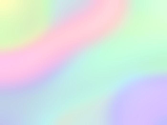 Defocused image of rainbow against bright sun