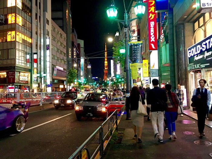 Night Life Illuminated Night City Building Exterior Street City Street Architecture City Life Travel Destinations Built Structure Car Road Full Length Nightlife Outdoors Large Group Of People Real People Neon People Horizontal