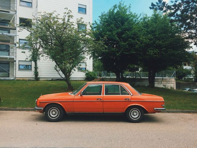 🍊//. Vintage Vintage Cars Orange Color Car Auto Streetphotography Street Transportation Mode Of Transport City Oldtimer Minimalism Minimal Style Town Colors Colorful Building Exterior Built Structure Outdoors Day Tree Live For The Story BYOPaper! The Street Photographer - 2017 EyeEm Awards