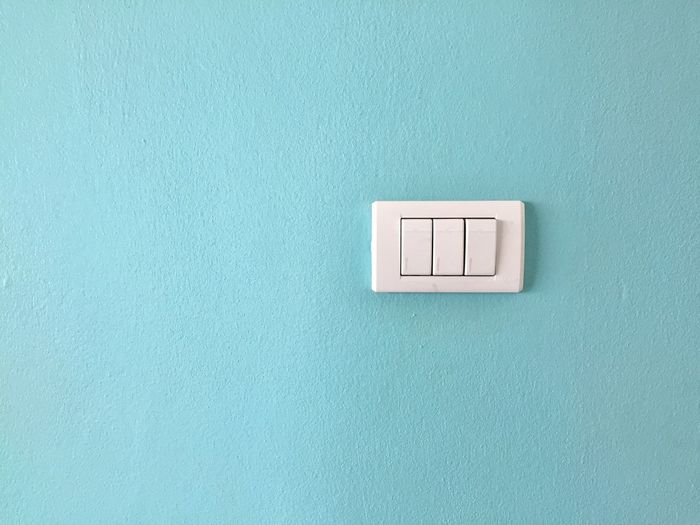 Close-up of electric light on wall