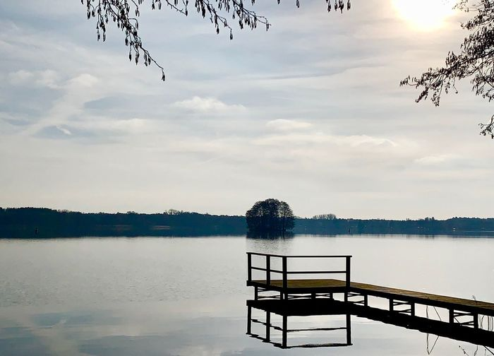 Water Sky Cloud - Sky Lake Beauty In Nature Nature Tranquility Scenics - Nature Reflection Day Tranquil Scene No People Plant Non-urban Scene Architecture Seat Pier Tree Outdoors