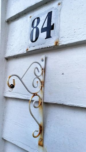 No People Close-up Architecture Old Wrought Iron Weathered Standing Post Street Number 84 Handcrafted Wall Mount