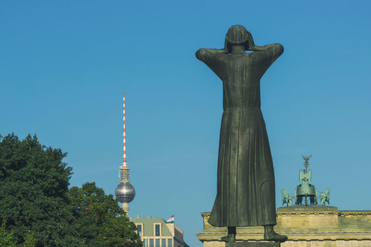 Statue 'Der Rufer' on Strasse des 17. Juni with Brandenburg Gate and TV Tower in Berlin, Germany Architecture Berlin Brandenburg Gate Brandenburger Tor City Color Image Day Der Rufer Germany🇩🇪 Horizontal No People Outdoors Photography Statue Statue Straße Des 17. Juni Tree Tv Tower Berlin