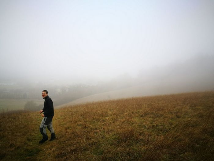 Full Length One Person Fog Nature One Man Only Only Men Outdoors People Tranquility Warm Clothing Beauty In Nature Day Adults Only Adult Sky Desaturated Community Outreach