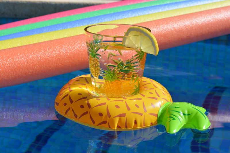 High angle view of multi colored drinking glass on table