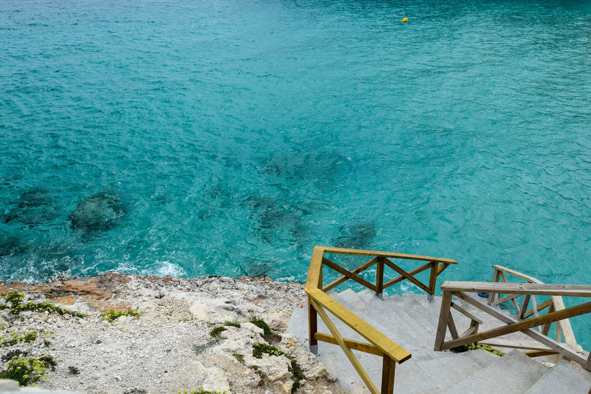Space For Text Beauty In Nature Blue Day High Angle View Idyllic Land Nature No People Outdoors Rock Rock - Object Scenics - Nature Sea Solid Staircase Tranquil Scene Tranquility Turquoise Colored Water Steps And Staircases Steps