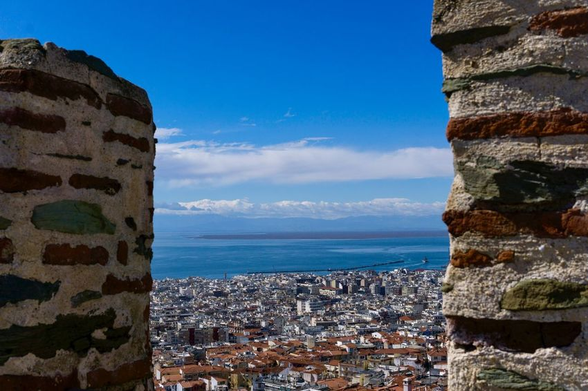 Bird's eye view of Thessaloniki from the Byzantine stone walls of Ano Poli. Byzantine Byzantine Architecture Port Travel Photography Travel Destinations Travel Landscape Horizon Thermaic Gulf Aegean Sea Buldings City View Castle Eptapirgio Ano Poli Thessaloniki Panoramic View Cityscape Sky Water Built Structure Building Exterior Stone Wall Building Land Day Blue Sunlight