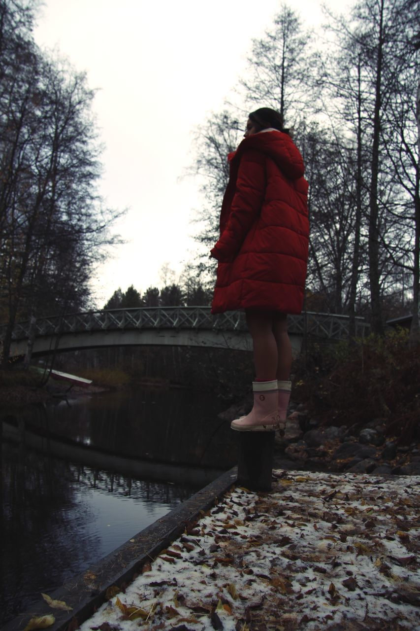 tree, one person, real people, plant, full length, nature, rear view, walking, lifestyles, water, clothing, sky, winter, day, women, leisure activity, cold temperature, outdoors, warm clothing, hood - clothing, canal