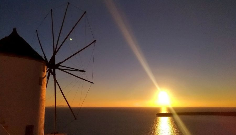 || Nature Theories || Santorini, Greece. TheFoneFanatic Zenfone Photography Vacations Mobilephotography PhonePhotography Scenics Colorful Wind Turbine Windmill Sea Sunset Seascape Silhouette Horizon Over Water Tranquil Scene Be Brave