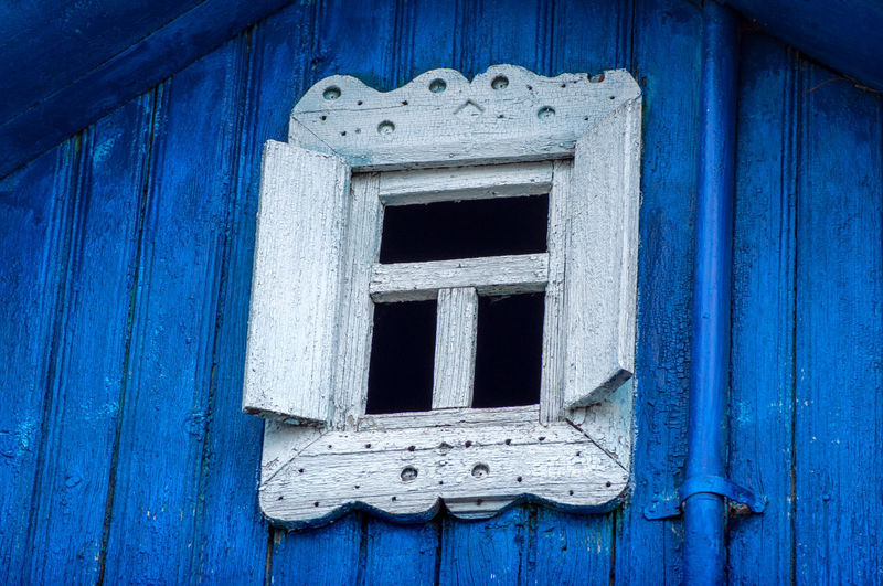 Close-up of closed door of old building