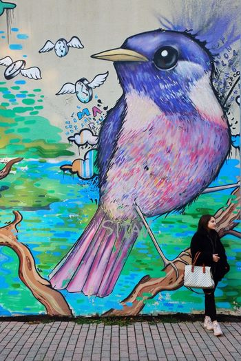 Sguardi opposti Fantasy Portrait Bestoftheday Photooftheday EyeEm Best Shots EyeEm Best Edits Girl Look Inspirational Canon5Dmk3 Artistic Expression Mural Art Real People Animal Art And Craft Creativity Animal Themes Multi Colored Bird Animal Wildlife Outdoors Graffiti Painted Painted Image Day Close-up Representation