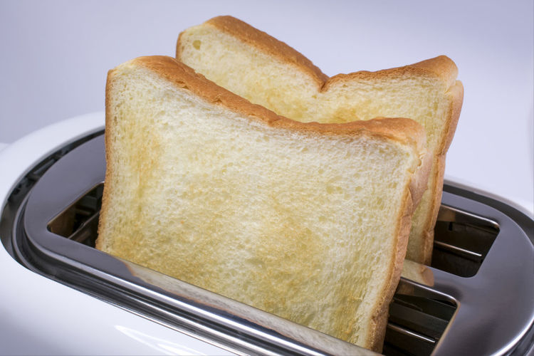 Bread from the Toaster Bread Breakfast Close-up Day Food Food And Drink Freshness Healthy Eating Indoors  No People Ready-to-eat SLICE Sliced Bread Toasted Toasted Bread Toaster White Background