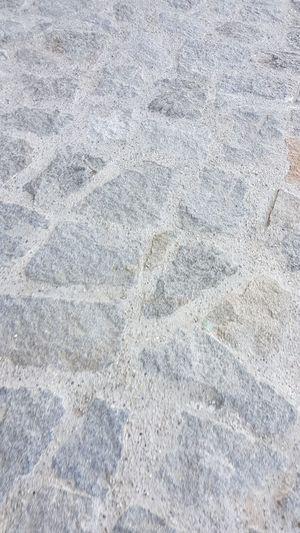 Full frame shot of rocks on tiled floor