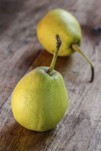 Pears Close-up Day Focus On Foreground Foodphotography Fruit Green Green Color Nature No People Organic Pear Pear Fruit Selective Focus Vitamins Wood - Material