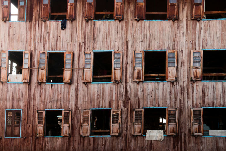 Full frame shot of open windows in wooden residential building