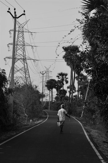 The Street Photographer - 2017 EyeEm Awards Tree Silhouette Wet Outdoors Day Bird Nature Sky People Water Animal Themes Adult Telephone Line Only Men Investing In Quality Of Life Breathing Space Mobility In Mega Cities