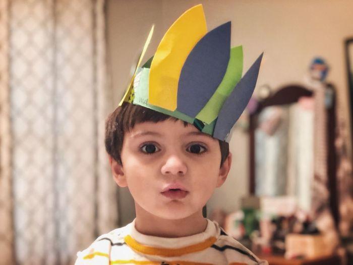 Portrait of cute boy wearing crown