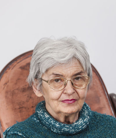 Portrait of a senior woman. Aged Close-up Elderly Elderly Woman Expression Eyeglasses  Face Gray Hair Headshot Lifestyles Looking At Camera Old One Person One Senior Woman Only Pensioner People Portrait Real People Retired Person Retirement Senior Adult Senior Women Studio Shot Wrinkled Wrinkled Face