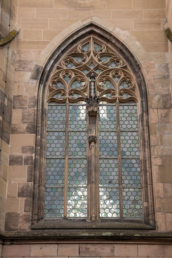 Window of an old historical building Architecture Built Structure Window Arch Building Religion Building Exterior Place Of Worship The Past Day History No People Belief Low Angle View Wall Spirituality Glass - Material Travel Destinations Outdoors Brick Glass Ornate
