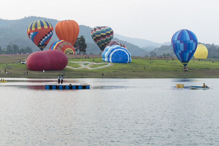 International Balloon Festival 2560 @ Singh Rai Park. Balloon Ballooning Festival Day Hot Air Balloon Lake Mode Of Transport No People Outdoors Reflection Transportation Water