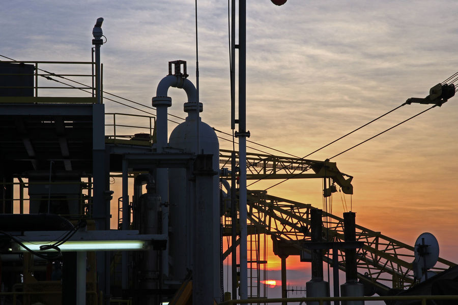 Sunset Over Oilrig Platform Bandung INDONESIA Red Sunset Silhouette Sunset Silhouettes Sunset And Clouds  Sunset_collection Bandungjuara Crane - Construction Machinery Indonesia Photography  Madura Island No People Oil Rig Platform Outdoors Platform Sky Sunset Sunset And Sea