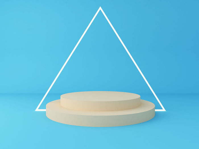 Close-up of empty table against blue background