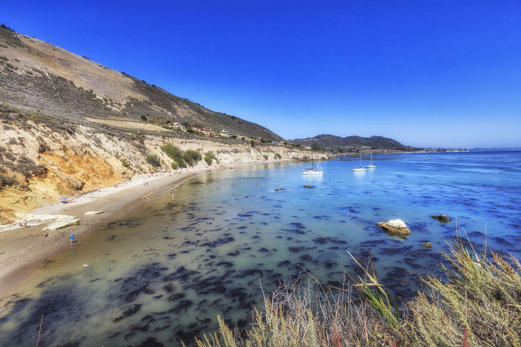 Pirate's Cove Beach Beach Beauty In Nature Blue California Calm Clear Sky Cove Day Geology Majestic Mountain Nature Non-urban Scene Outdoors Physical Geography Pirates Cove Rock Formation Scenics Sea Tourism Tranquil Scene Tranquility USA Vacations Water
