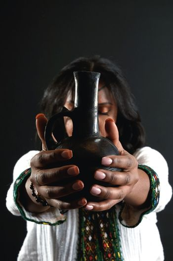 coffee jar African Coffee Jar Human Hand Black Background Portrait Studio Shot Headshot Human Face Black Color Young Women Front View Close-up Fingernail Make-up