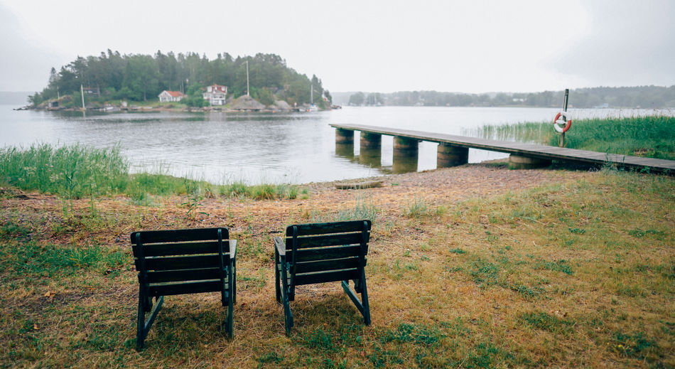Empty benches by river